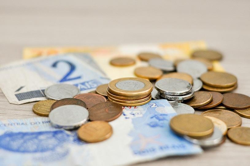 Troco em dinheiro ou uma balinha? Os direitos dos consumidores na hora do pagamento